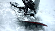 HD Super Slow-Mo: Snowboard Laying In The Snow video