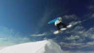 HD Super Slow-Mo: Snowboarder Jumping Over Snow Hill video