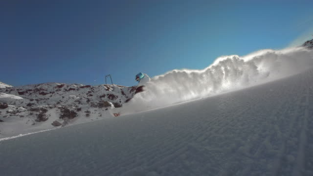 HD Super Slow-Mo: Snowboarder Spraying Snow At Camera video