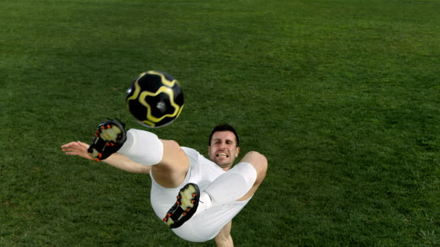 HD Super Slow-Mo: Soccer Player Doing Bicycle Kick video