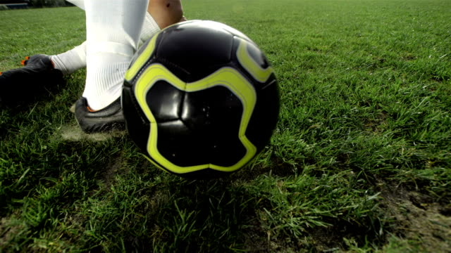 HD Super Slow-Mo: Soccer Player Performing A Sliding Tackle video