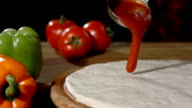 HD Super Slow-Mo: Spreading Tomato Sauce On Dough video