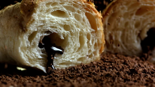 HD Super Slow-Mo: Sprinkling Chocolate Flakes Over Croissants video