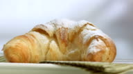 HD Super Slow-Mo: Sprinkling Powdered Sugar Over Croissant video