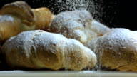 HD Super Slow-Mo: Sprinkling Powdered Sugar Over Croissants video