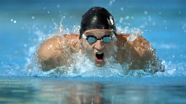 HD Super Slow-Mo: Swimmer Training The Butterfly Stroke video