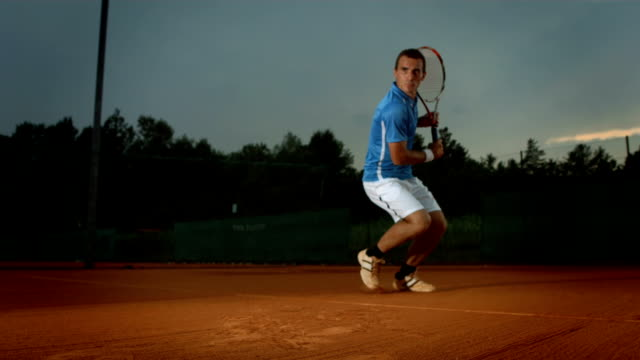 HD Super Slow-Mo: Tennis Player Hitting The Ball video