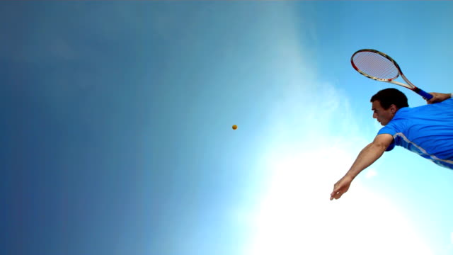 HD Super Slow-Mo: Tennis Player Serving Against Clear Sky video