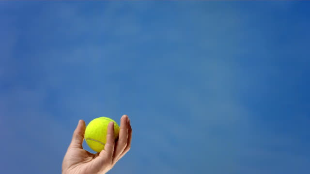 HD Super Slow-Mo: Tennis Player's Hand Tossing The Ball video