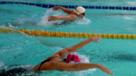 HD Super Slow-Mo: Two Young Women Swimming Butterfly Stroke video