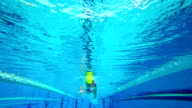 HD Super Slow-Mo Underwater: Young Woman Swimming Front Crawl video