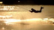HD Super Slow-Mo: Wakeboarder Jumping At Sunset video