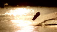 HD Super Slow-Mo: Wakeboarder Performing Jumping Trick At Sunset video