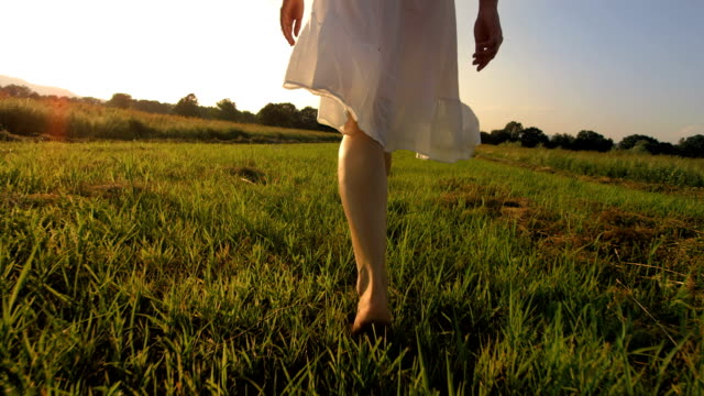 HD Super Slow-Mo: Walking Barefoot In The Grass video
