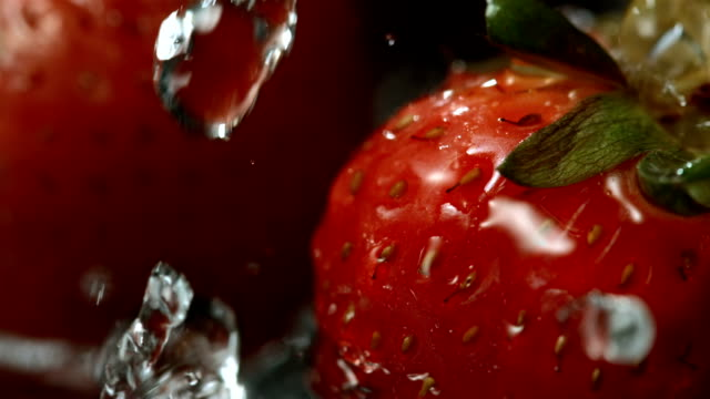 HD Super Slow-Mo: Water Drops Falling On A Strawberry video