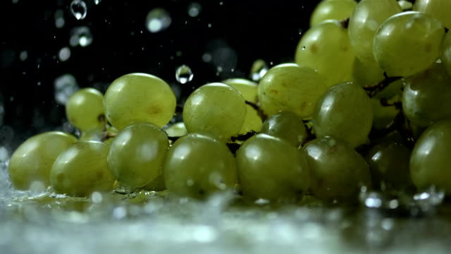 HD Super Slow-Mo: Water Drops Falling On Grapes video