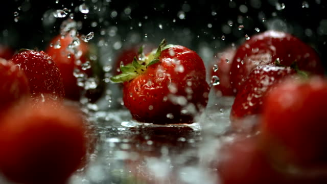 HD Super Slow-Mo: Water Drops Falling On Strawberries video