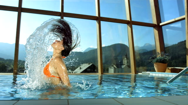 HD Super Slow-Mo: Woman Flipping Hair In The Pool video