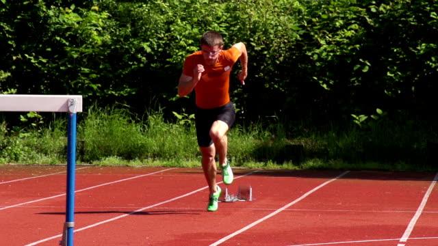 HD Super Slow-Mo: Young man at 110m hurdle run video