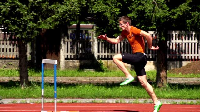 HD Super Slow-Mo: Young man at hurdle run video