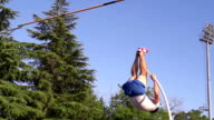 HD Super Slow-Mo: Young Man at Pole Vaulting video