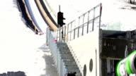 HD Super Slow-Mo: Young Man Performing Ski Jump video