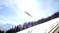 HD Super Slow-Mo: Young Man Performing Ski Jump video