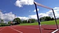 HD Super Slow-Mo: Young man running over hurdles video