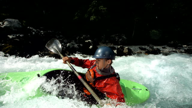 HD Super Slow-Mo: Young Whitewater Kayaker video