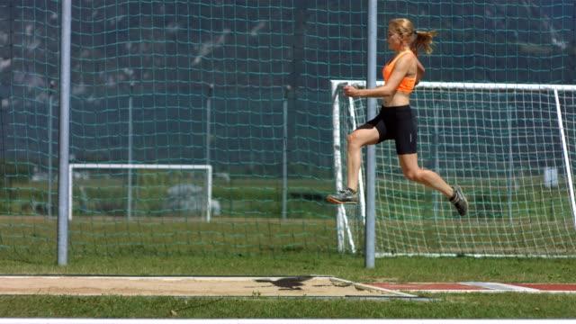 HD Super Slow-Mo: Young Woman At Long Jump video