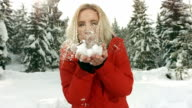 HD Super Slow-Mo: Young Woman Blowing Snow video
