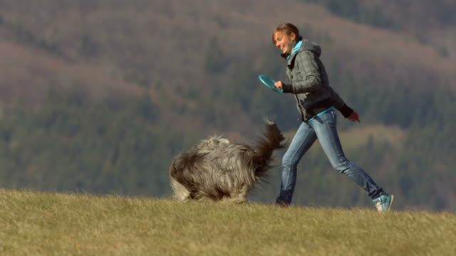HD Super Slow-Mo: Young Woman Running With Her Dog video