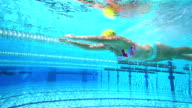 HD Super Slow-Mo: Young Woman Swimming Breaststroke video