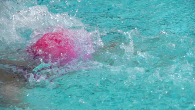 HD Super Slow-Mo: Young Woman Swimming Butterfly video