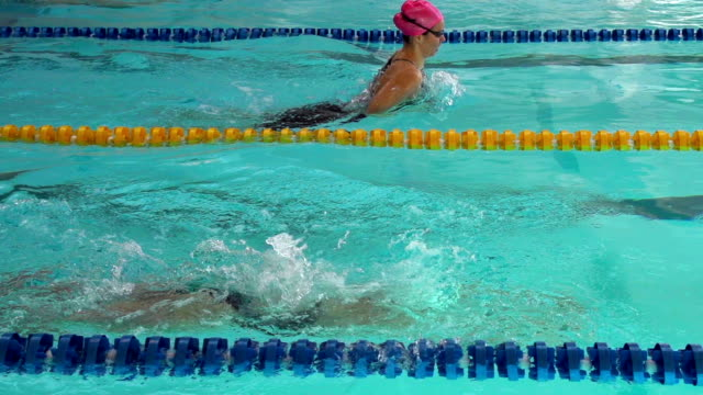 HD Super Slow-Mo:Two Young Women During Swimming Competition video