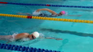 HD Super Slow-Mo:Two Young Women Swimming Front Crawl video