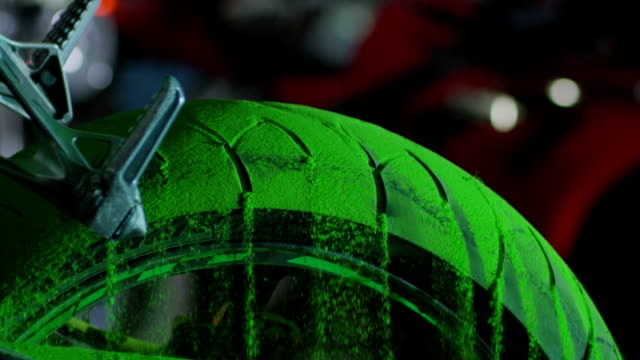 Super sport motorcycle tire with colorful sand. Shot on RED EPIC Cinema Camera in slow motion. video
