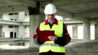 Supervisory personnel at construction site video