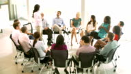 Support Group Meeting With People Seated In Circle Of Chairs video