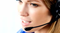 Support phone operator in headset talking and smiling video