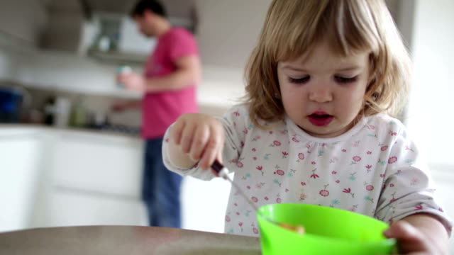 Supportive Dad Little Girl Eats Breakfast video