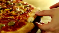 Supreme pizza lifted slice, slow motion video