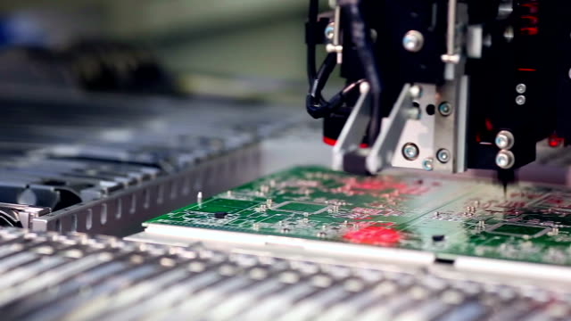 Surface Mount Technology Machine places elements on circuit boards video