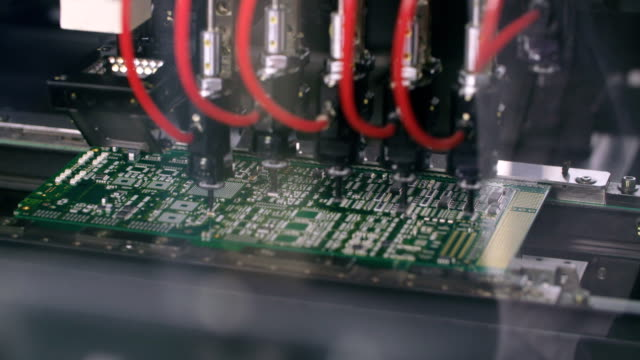 Surface Mount Technology (Smt) Machine places elements on circuit boards video