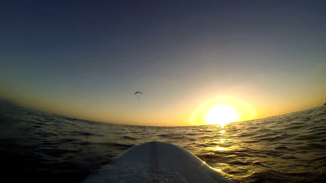 surfboard and paraglider video