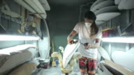 Surfboard making, shaper sanding the side of the surfboard video