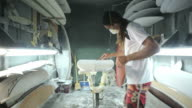 Surfboard making, Shaper sands the surfboard with a sanding block video