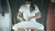 Surfboard making, Shaper using a foam sander to shape the nose of the surfboard video