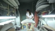 Surfboard shaping, Shaper hand sanding surfboard video