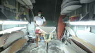Surfboard shaping, Shaper using blower to blow the foam of the surfboard blank video